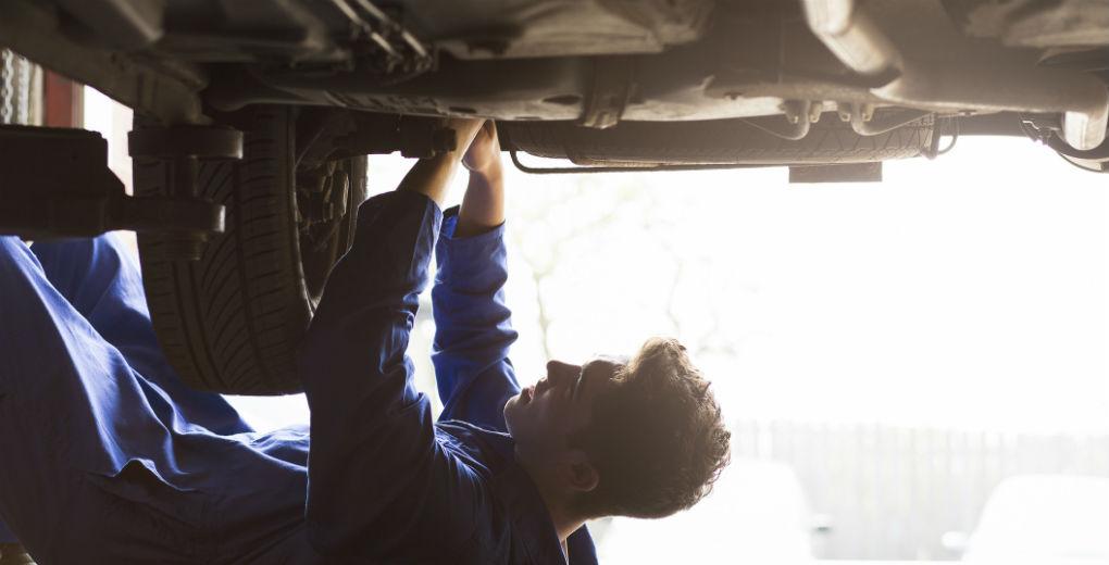 Mechanic fixing car blue jumpsuit